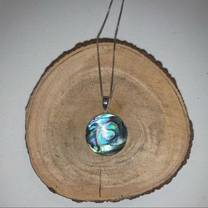 Sterling silver pendant, onyx and abalone accents